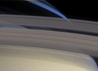 Excerpt of NASA/JPL/Space Science Institute image PIA06060  showing Saturn's rings and atmosphere from the Cassini space probe