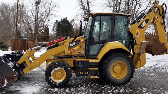 Moving snow with a backhoe