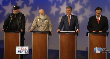 Still from the debate video: the four candidates