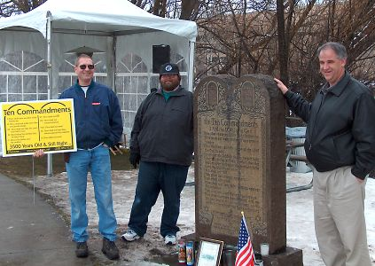 Three guys at a vigil for the Ten Commandments monument on public  property in Boise