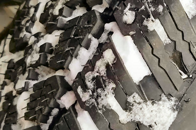 One of the new tires, and snow