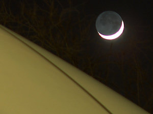Crescent moon over the Boas Tennis Center bubble roof