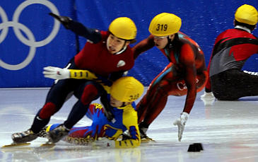 AP Photo: Apolo Anton Ohno of the United States collides with Korea's Ahn Hyun-Soo and Mathieu Turcotte of Canada in the final streach of the men's 1000-meter short track speedskating race at the Winter Olympics in Salt Lake City on Saturday, Feb. 16.