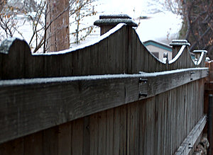 First snow at first light, the neighbor's fence
