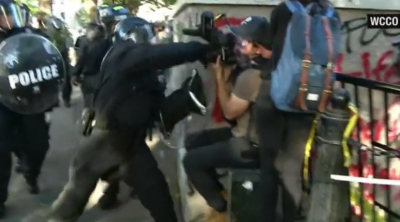 Screencap of WCCO video of police rioting against protesters and journalists