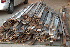 The old cedar fence, stacked for pickup
