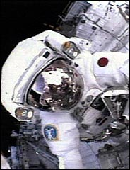 NASA image of Soichi Noguchi working in Discovery's cargo bay