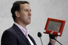 Rick Santorum is very pleased to hold an Etch-a-Sketch