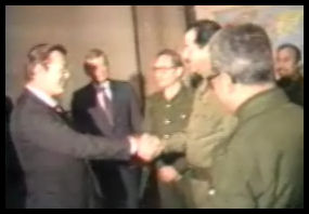 Donald Rumsfeld shaking hands with Saddam Hussein, Dec. 20, 1983
