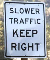 Road sign: SLOWER TRAFFIC KEEP RIGHT