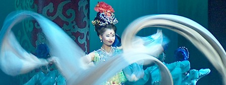 The Empress swirling her costume in the Tang Dynasty show