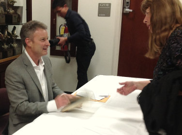Timothy Egan signing books after his talk